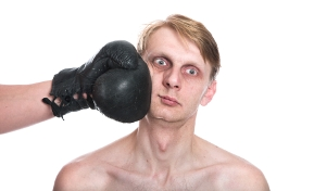 image of boxer taking a punch