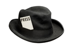 image of journalist hat with press pass