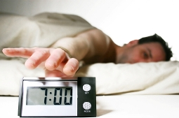image of man with alarm clock